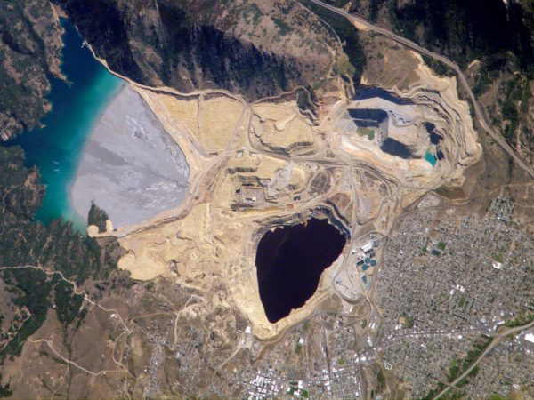 An open pit mine in Montana, the Berkeley Pit, has leached dangerous levels of metals into the water and is classified as a Superfund site. It's so large you can see it from the International Space Station--which is how this photo was taken. Photo: NASA. | Miles O'Brien Productions