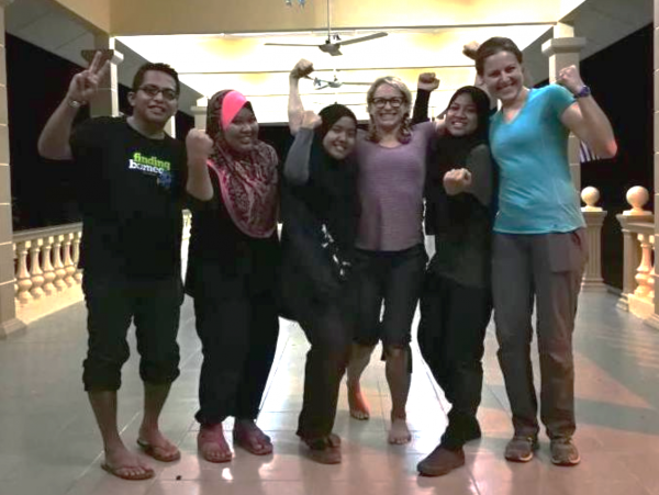 The research team triumphant after releasing our last bird at 1:30am. Left to right: Mohiddin, Asmalia, Wardah, Liz, Nabila, and Amanda. Photo credit: the nice fisherman using Liz's phone. | Miles O'Brien Productions