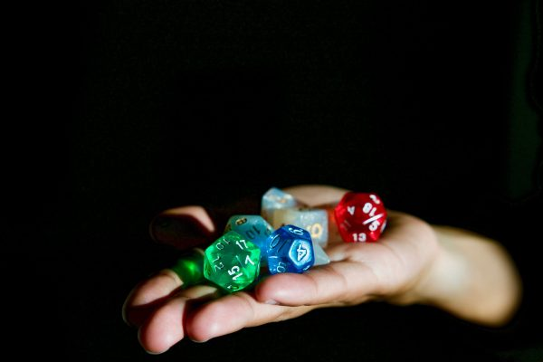 Not only does God play dice, the dice are loaded. Credit: Alex Chambers | Unsplash. | Miles O'Brien Productions