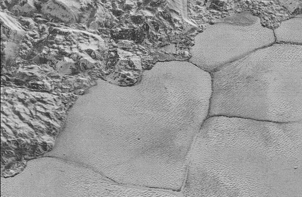 Rippling dunes on a flat plain of Pluto, imaged by the New Horizons spacecraft. Credit: NASA. | Miles O'Brien Productions