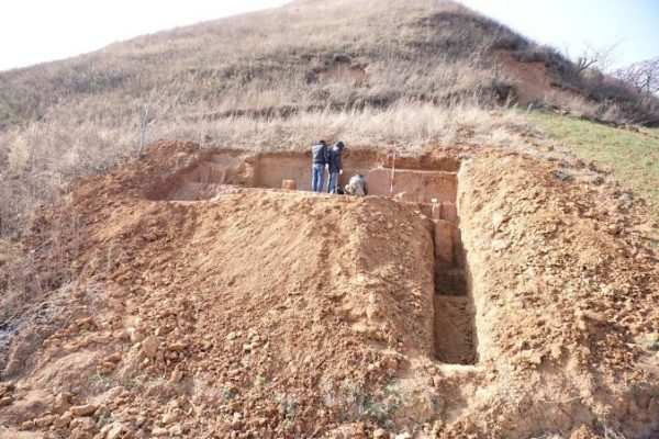 Archaeologists carefully cut into a steep hillside in Shangchen, China. Credit: Zhaoya Zhu. | Miles O'Brien Productions